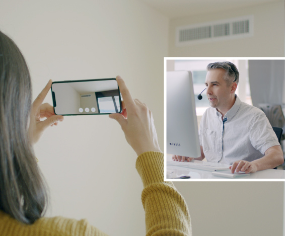 A technician uses Streem to show a customer how to fix a vent problem using remote AR-powered video