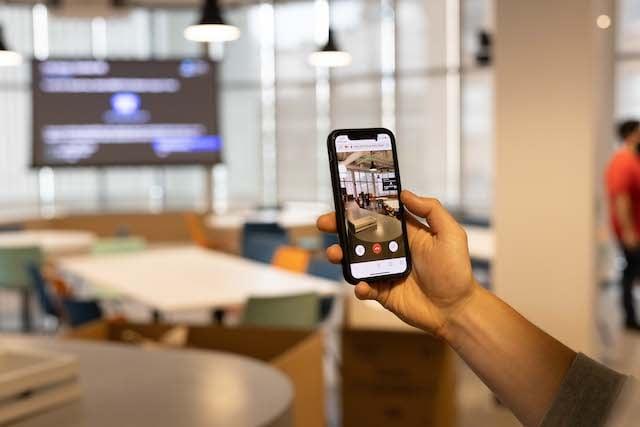 Office wide kitchen shot with app focus