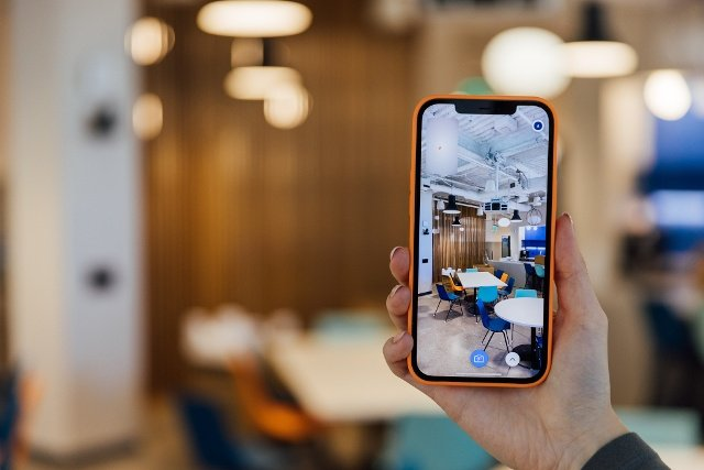 An iphone 12 pro is using Streem Onsite video tools with AR capabilities to document a colorful kitchen.